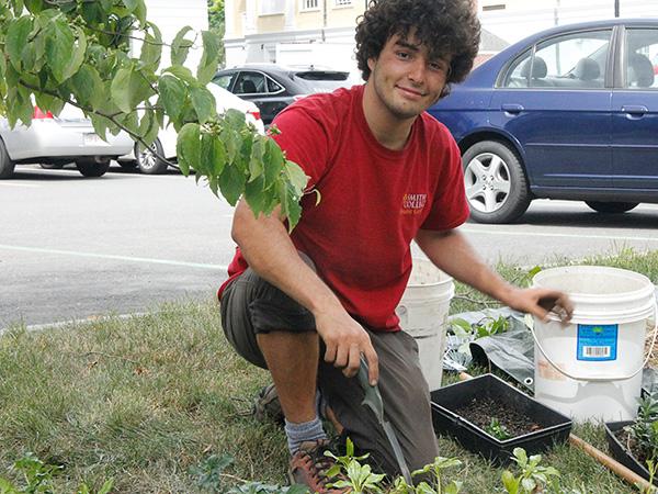 Summer intern Joey Staluppi planting groundcover plants