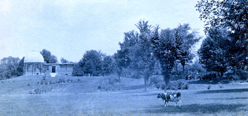 Smith College Observatory with President Seelye's cow in the foreground, 1901