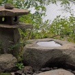 Stone lantern and rock wash basin with view of Paradise Pond, 2017