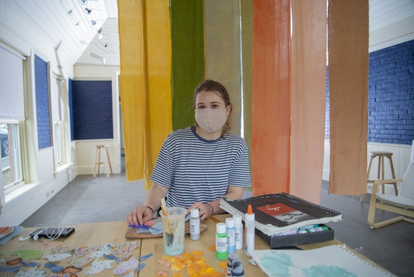 Julia Mettler-Grove '21 working on her collage in the Church Exhibition Gallery