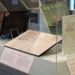 "Display case with early drafts of Sylvia Plath's poem ""Among the Narcissi"" and ""New Yorker"" Magazine with published poem"