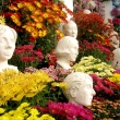 sculptures and mums