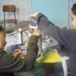 Homework House students making paper mache plant sculptures.