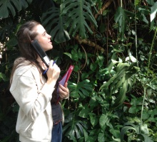 student listening to the audio tour in the conservatory