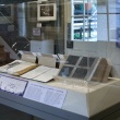 display case with artist's notebooks and photograph negatives