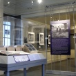 display case, info panel and images from the exhibit