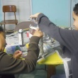 Homework House students making paper mache plant sculptures.
