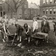 students digging in lawn to create the garden